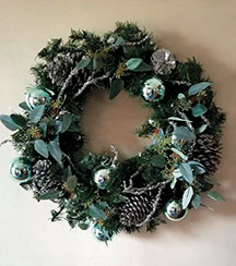 56a4a6b5 Award-winning designer Julie Kleski specializes in wreaths, garlands, and  swags.